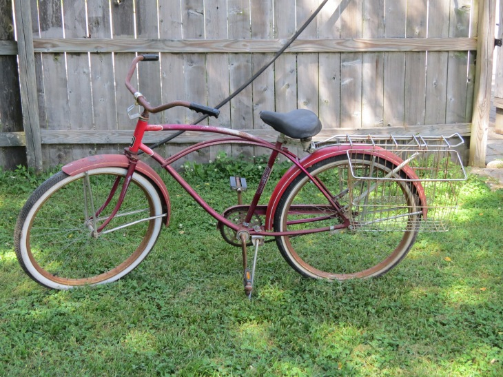Adult Mitchell drives an antique car. Teen Mitchell gets around town on this old bike.