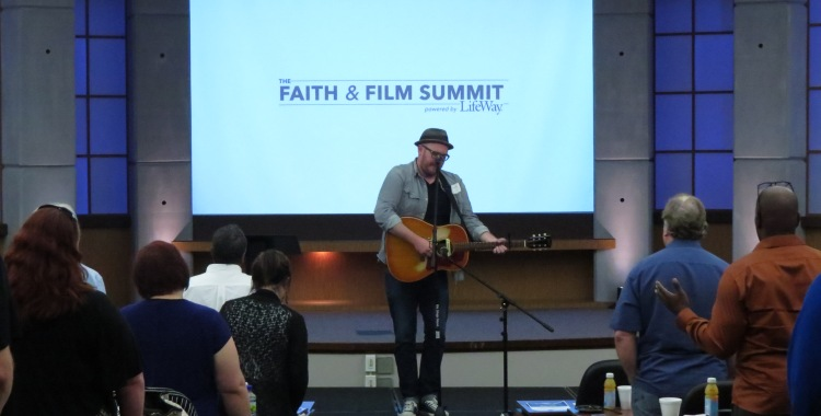 Recording artist and worship leader Chris McClarney leading in worship.