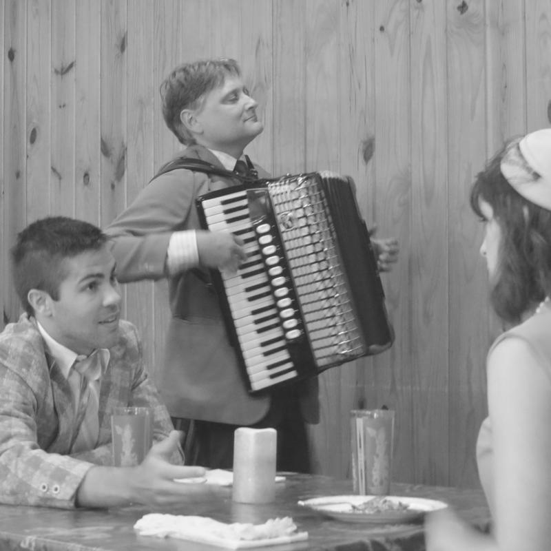 Actors Cameron Gilliam and Rachel Schrey listen to Heino Mueller during filming of Summer of '67 movie