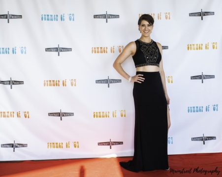 Actress Rachel Schrey poses on the red carpet of the Summer of '67 red carpet premiere