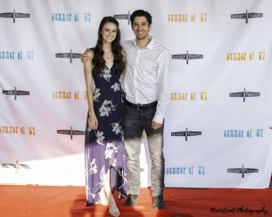 Actors Bethany Davenport and Christopher Dalton pose on the red carpet of the Summer of '67 red carpet premiere