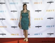 Actress Mimi Sagadin poses on the red carpet of the Summer of '67 red carpet premiere