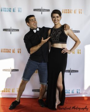 Actors Cameron Gilliam and Rachel Schrey pose on the red carpet of the Summer of '67 red carpet premiere
