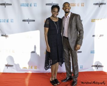 Actors Sharonne Lanier and Jerrold Edwards pose on the red carpet of the Summer of '67 red carpet premiere