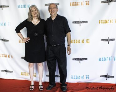 Filmmakers Fred and Sharon Wilharm pose on the red carpet of the Summer of '67 red carpet premiere